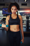 Strong fit girl weightlifting at fitness center Stock Photos