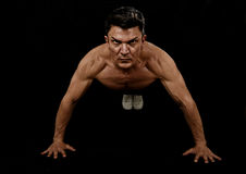 Strong fit sport man doing push up workout training on gym posing with naked torso ripped shoulders. Strong and fit sport man doing push up workout training on royalty free stock image
