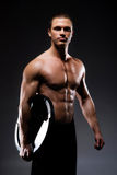 Strong, fit and sporty bodybuilder man Royalty Free Stock Photography
