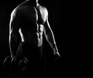 Strong, fit and sporty bodybuilder man with a dumbbell Royalty Free Stock Images