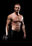 Strong, fit and sporty bodybuilder man with a dumbbell Royalty Free Stock Photo