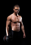 Strong, fit and sporty bodybuilder man with a dumbbell Stock Image