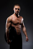 Strong, fit and sporty bodybuilder man Stock Images