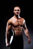 Strong, fit and sporty bodybuilder man Stock Photos