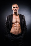 Strong, fit and sporty stripper man. Over black background Royalty Free Stock Images