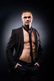 Strong, fit and sporty stripper man. Over black background Stock Image