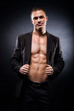 Strong, fit and sporty stripper man. Over black background Royalty Free Stock Photography