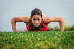 Strong fit woman doing push ups Royalty Free Stock Image