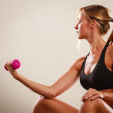 Strong fit woman exercising with dumbbell. Stock Photo