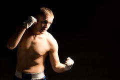 Strong fit young boxer fighting in a match Royalty Free Stock Photography