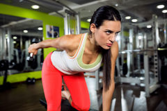 Strong fitness angry girl doing training with weight Royalty Free Stock Photography