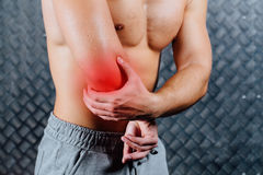 Strong fitness man feeling pain. Stock Photography