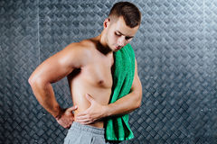 Strong fitness man feeling pain. Royalty Free Stock Photography