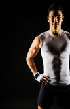 Strong fitness man relaxing after workout Stock Photography