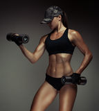 Strong fitness woman bodybuilder Royalty Free Stock Photo