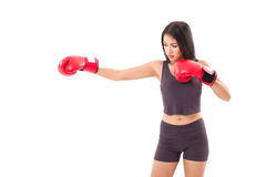 Strong fitness woman boxer or fighter punching at blank space Royalty Free Stock Image