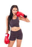 Strong fitness woman boxer or fighter punching her cheek pose Stock Photos