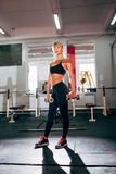 Strong fitness woman holding dumbbells Royalty Free Stock Images