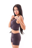 Strong fitness woman practice martial arts, boxing. Strong sporty fitness woman practice martial arts, boxing Royalty Free Stock Image