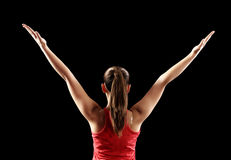 Strong fitness woman showing back biceps muscles Royalty Free Stock Image