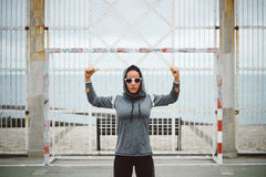 Strong fitness woman showing biceps Royalty Free Stock Photography