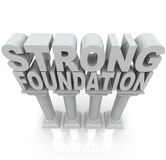 Strong Foundation Words on Granite Marble Columns. The words Strong Foundation atop large granite or marble columns to symbolize strength, resilience Stock Images