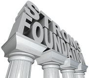 Strong Foundation Words on Marble Pillars Columns. The words Strong Foundation in marble stone letters standing on white grantie pillars or columns to convey Royalty Free Stock Photos