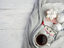 Strong, fragrant coffee in a white cup, cookies and Christmas decorations. On a woolen blanket Stock Images