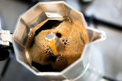 Strong fresh steaming coffe made in Italian style cafetiere Royalty Free Stock Images