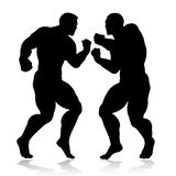 Strong giant silhouettes fighting. Isolated on white Royalty Free Stock Images