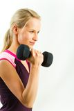 Strong girl. Portrait of strong girl lifting black barbell on a white background Royalty Free Stock Images