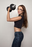 Strong girl with dumbbell Royalty Free Stock Photos