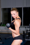 Strong girl in gym Royalty Free Stock Photos
