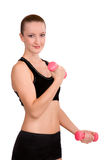 Strong girl lifting barbells Royalty Free Stock Photography