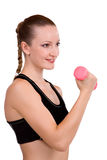 Strong girl lifting barbells Stock Images