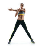 Strong girl with perfect body performs fitness exercises on white background Stock Photo