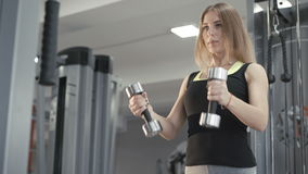 Strong girl working out with dumb-bell for delta muscles in 4K.  stock video