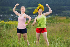 Strong girls. Girls teenagers playing the fool they show what strong royalty free stock photos