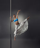 Strong and graceful girl dancing on pylon Royalty Free Stock Photos