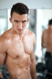 Strong guy in the gym Stock Photography