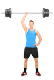 Strong guy holding a barbell in one hand Stock Photos