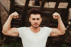 Strong guy with a tattoo on his arm outside Stock Images