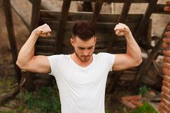 Strong guy with a tattoo on his arm outside Royalty Free Stock Images