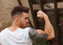 Strong guy with a tattoo on his arm Royalty Free Stock Photography