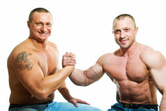 Strong guys. Portrait of two strong guys with success sign royalty free stock image