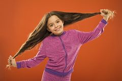 Strong hair concept. Kid girl long healthy shiny hair. Main thing is keeping it clean. Use gentle shampoo and warm water. Little girl grow long hair. Teaching royalty free stock images