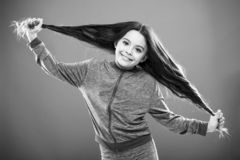 Strong hair concept. Kid girl long healthy shiny hair. Main thing is keeping it clean. Use gentle shampoo and warm water. Little girl grow long hair. Teaching royalty free stock photos