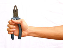 Hand hold the blue pliers with .jisolated backgroundp Royalty Free Stock Images