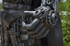 Strong hand of scrap predator close up. Strong hand of predator close up made from scraps Stock Image