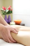 Strong hands doing massage therapy to legs Royalty Free Stock Image
